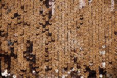 36901023-Shiny-sparkle-gold-sequins-great-for-texture-or-background-Glittering-sequins-wall-Stock-Photo.jpg